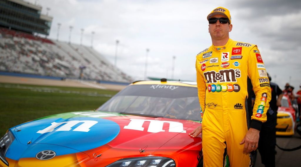 Kyle Busch in front of his M&Ms Toyota before winning his 100th Xfinity race